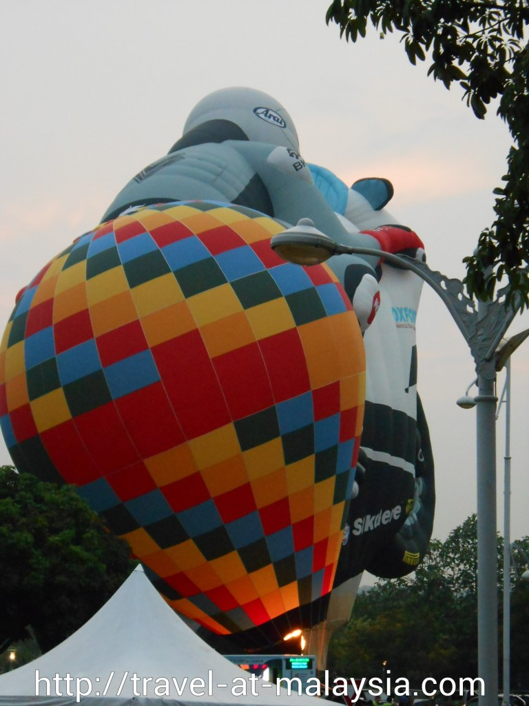 The biggest balloon too bad its behind the colourful balloon